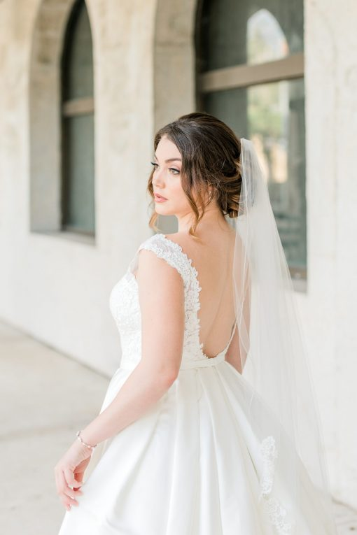 off the shoulder alencon lourd lace ball gown with box pleat skirt