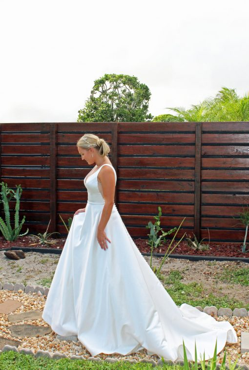 Sleeveless low back wedding gown