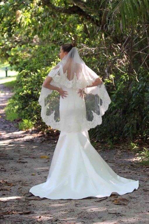 satin mermaid wedding gown with veil
